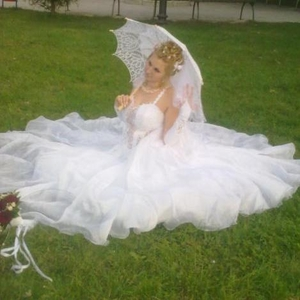 Продам свадебное платье (7 колец)